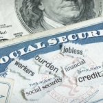 15159832 - newspaper headlines and social security cards with cash